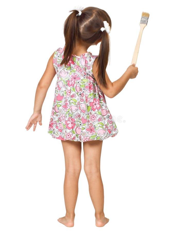 Petite fille avec le pinceau photo libre de droits