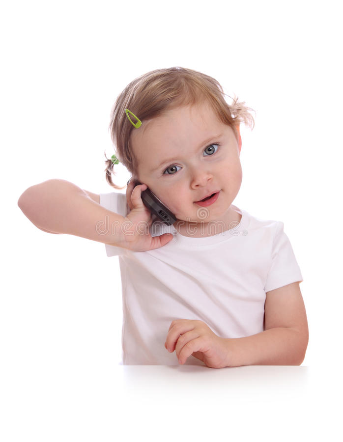 Petite fille avec le téléphone images stock