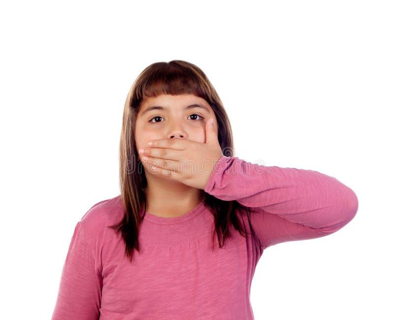 Petite fille avec onze années couvrant sa bouche photo stock