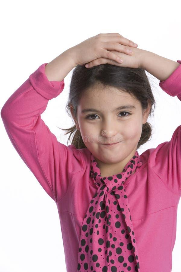 Petite fille avec une expression timide photographie stock
