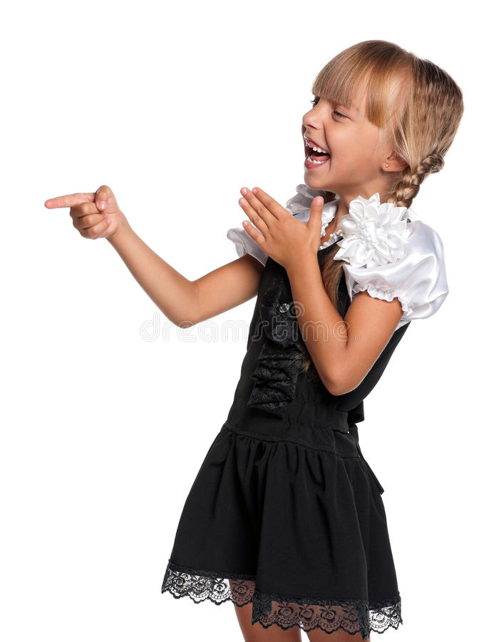 Petite fille dans l'uniforme scolaire photo stock