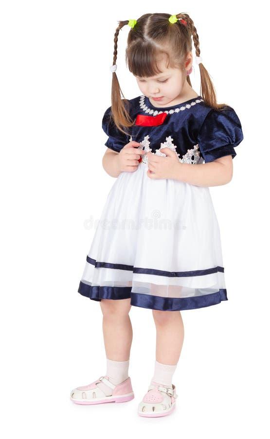 Petite fille dans la belle robe timide photos stock