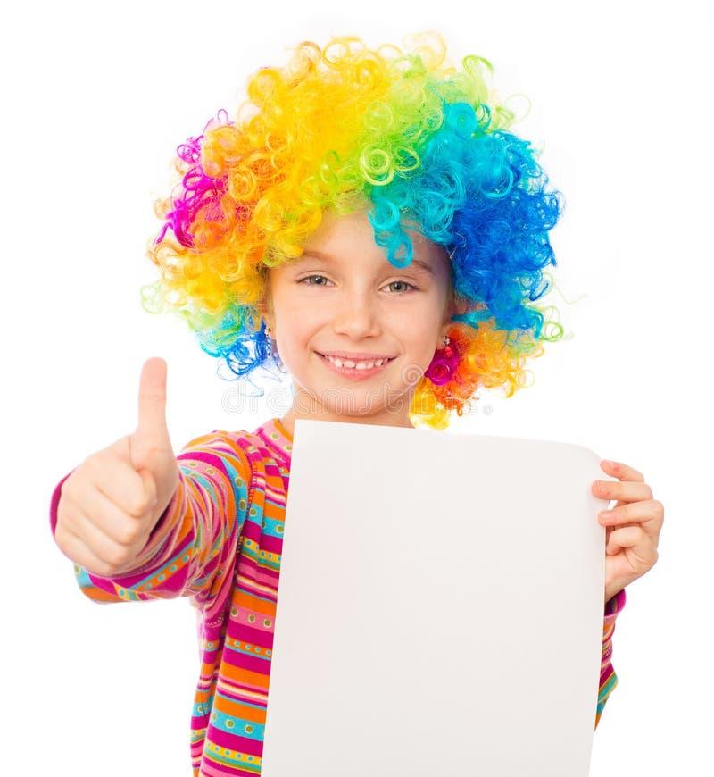 Petite fille dans la perruque de clown photo stock