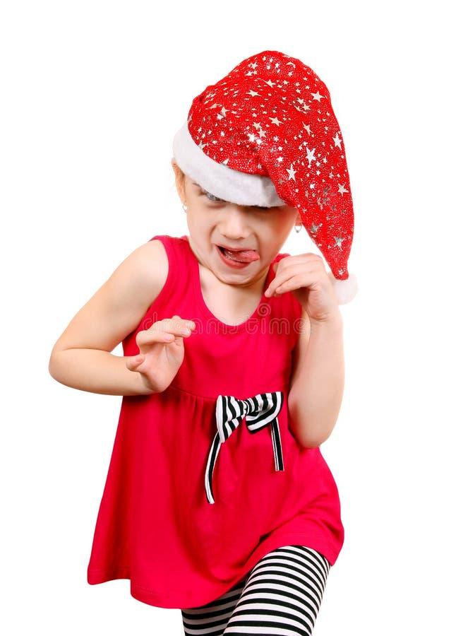 Petite fille dans le chapeau de Santa photos libres de droits
