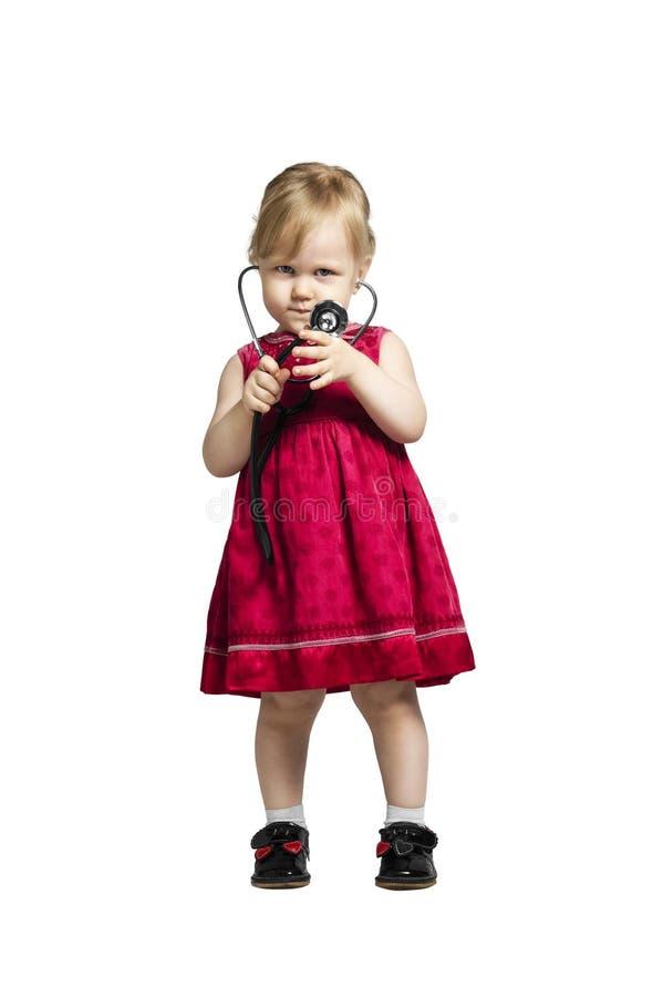 Petite fille dans le docteur photographie stock