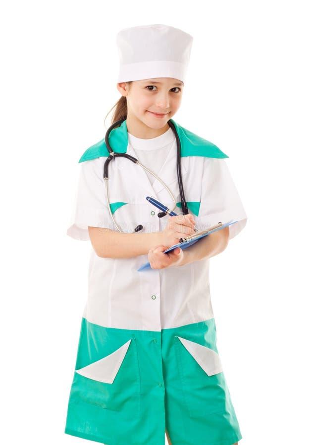 Petite fille dans un costume de docteur photographie stock