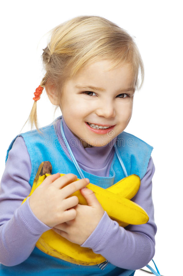 Petite fille de sourire avec des bananes photos libres de droits