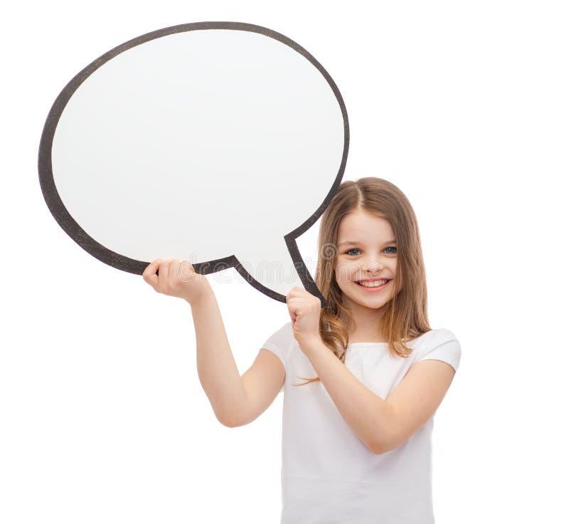 Petite fille de sourire avec la bulle vide des textes photo libre de droits