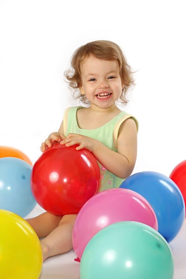 Petite fille et ballons. images stock