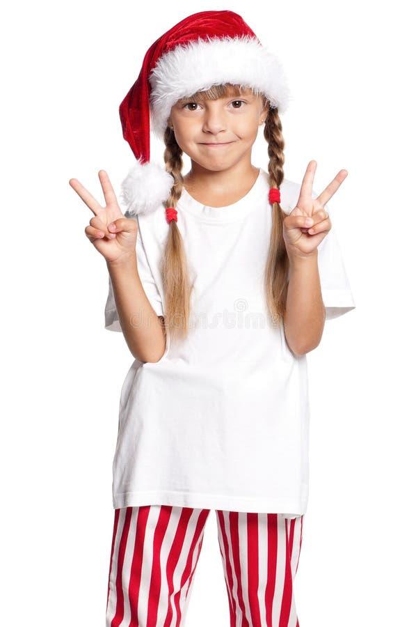 Petite fille heureuse dans le chapeau de Santa image libre de droits