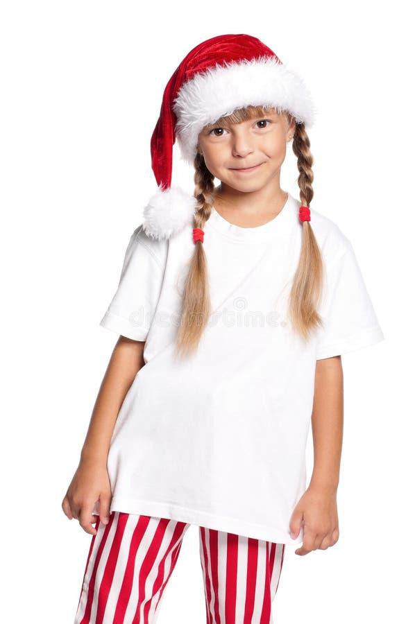Petite fille heureuse dans le chapeau de Santa photos libres de droits