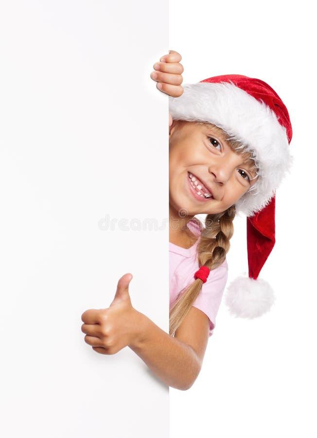 Petite fille heureuse dans le chapeau de Santa images stock