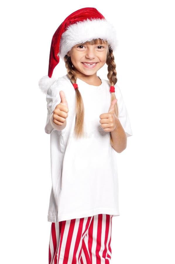 Petite fille heureuse dans le chapeau de Santa images libres de droits