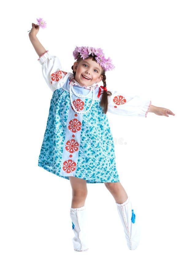Petite fille heureuse dans le costume de slavic d'isolement photo libre de droits