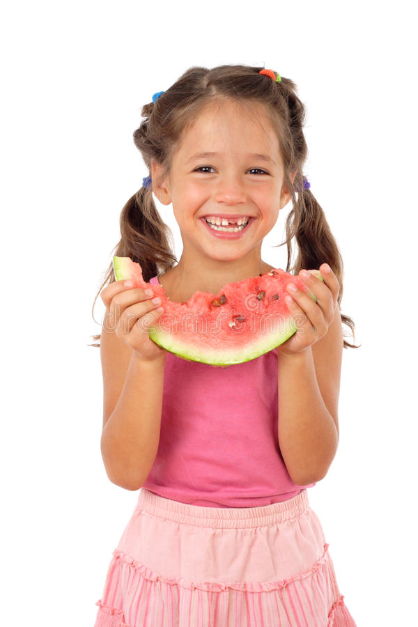Petite fille mangeant la pastèque photographie stock
