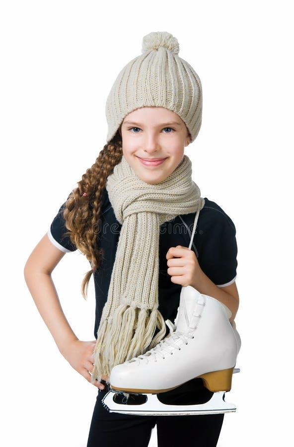 Petite fille mignonne avec la figure patins image libre de droits