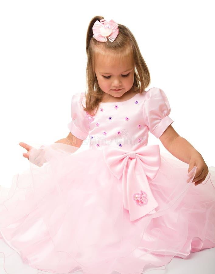 Petite fille mignonne dans la robe rose photographie stock