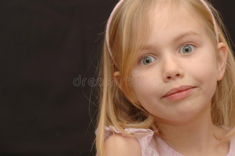 Petite fille mignonne et exaspérée images libres de droits