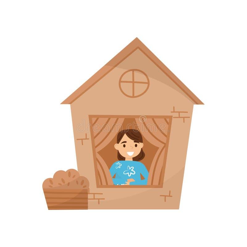 Petite fille mignonne jouant dans la maison faite de boîtes en carton Enfant s'asseyant dans la maison de théâtre Dreems d'été Co illustration stock