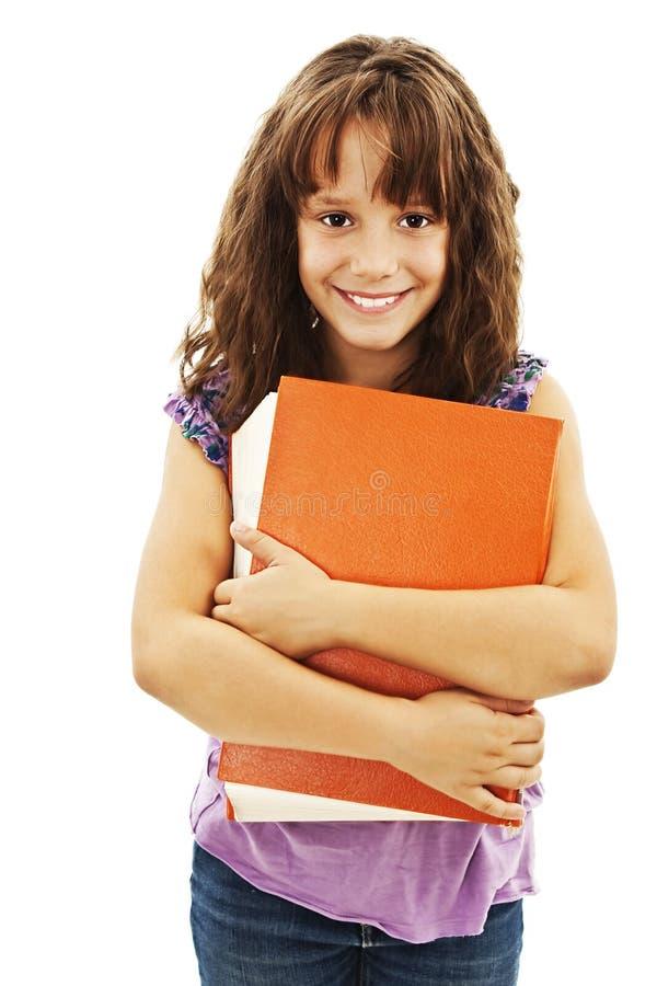 Petite fille retenant un grand livre. photographie stock