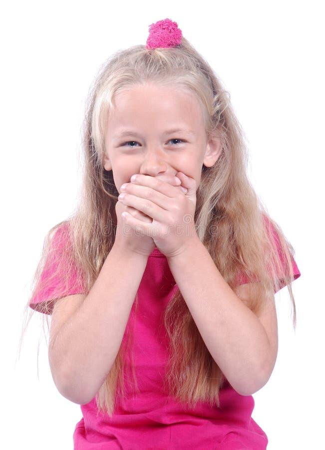 Petite fille riant nerveusement photo libre de droits