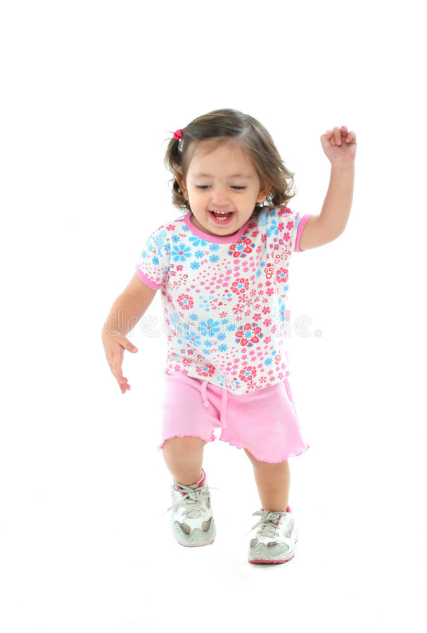 Petite fille souriant et dansant images stock