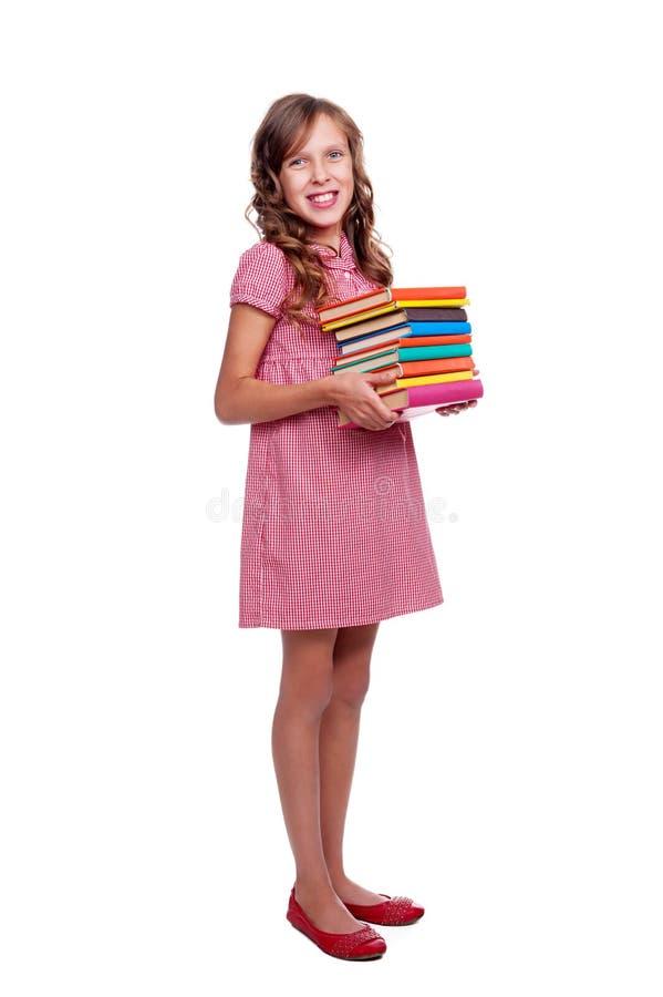Petite fille souriante avec des livres images stock