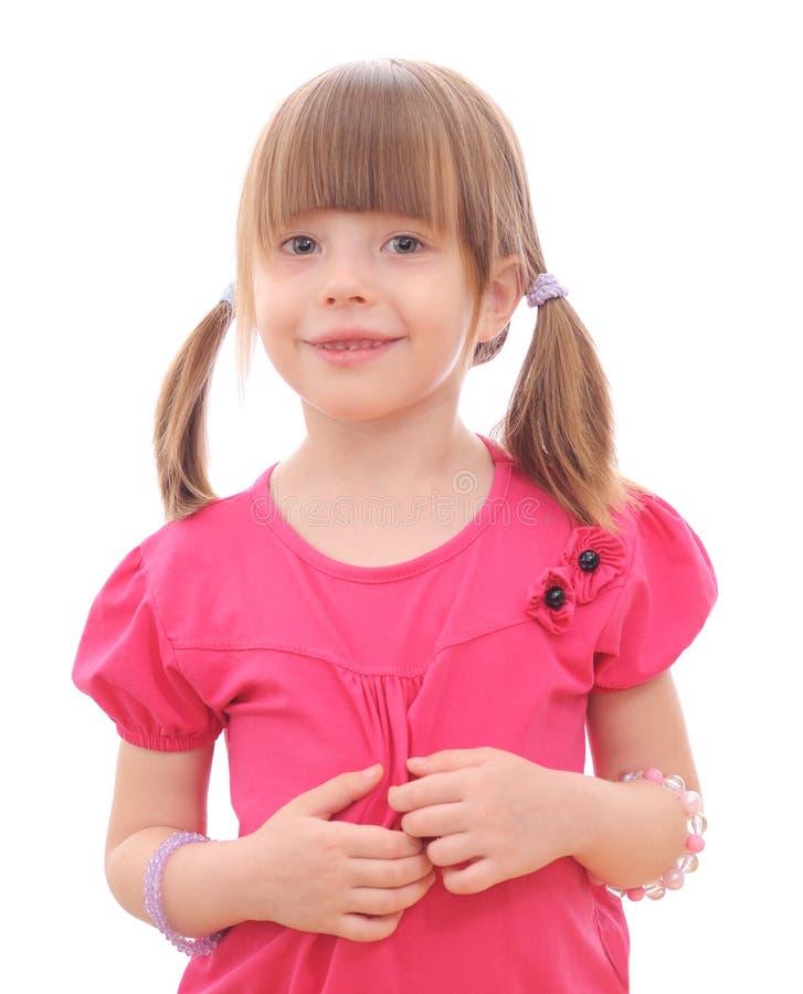 Petite fille sur le fond blanc image stock