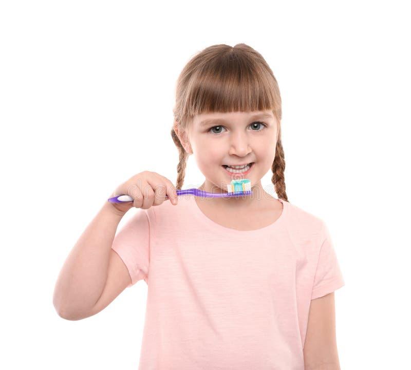 petites dents de brossage de fille images stock
