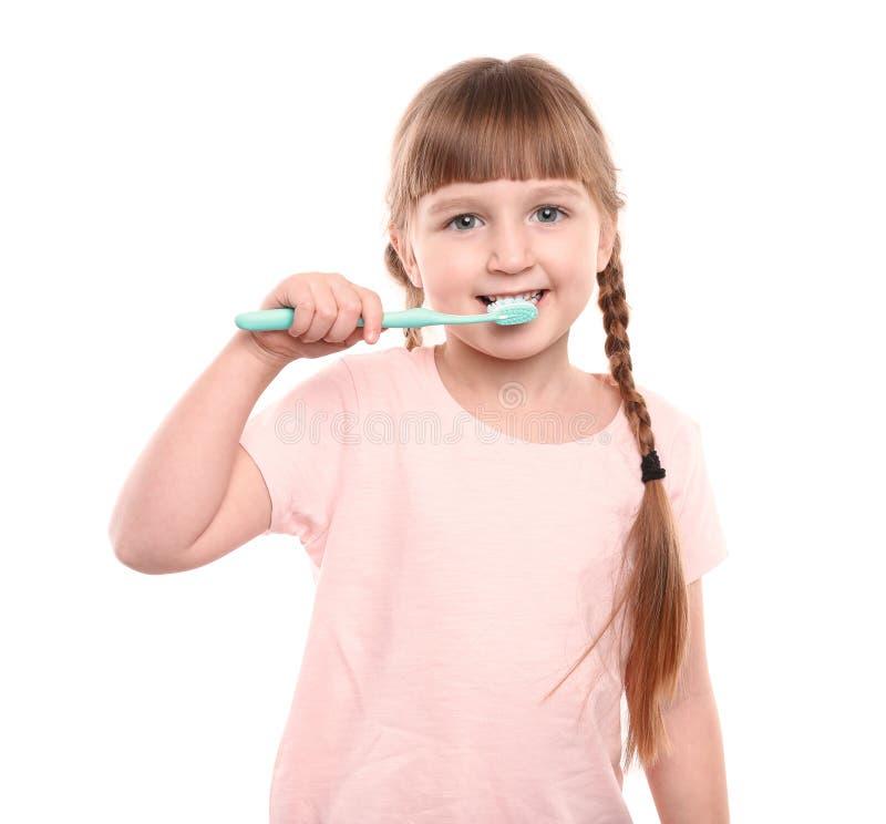 petites dents de brossage de fille photo stock