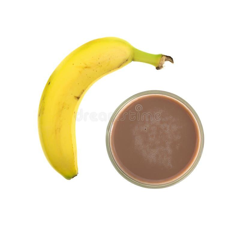 Petites et grandes bananes sur un fond blanc photographie stock libre de droits