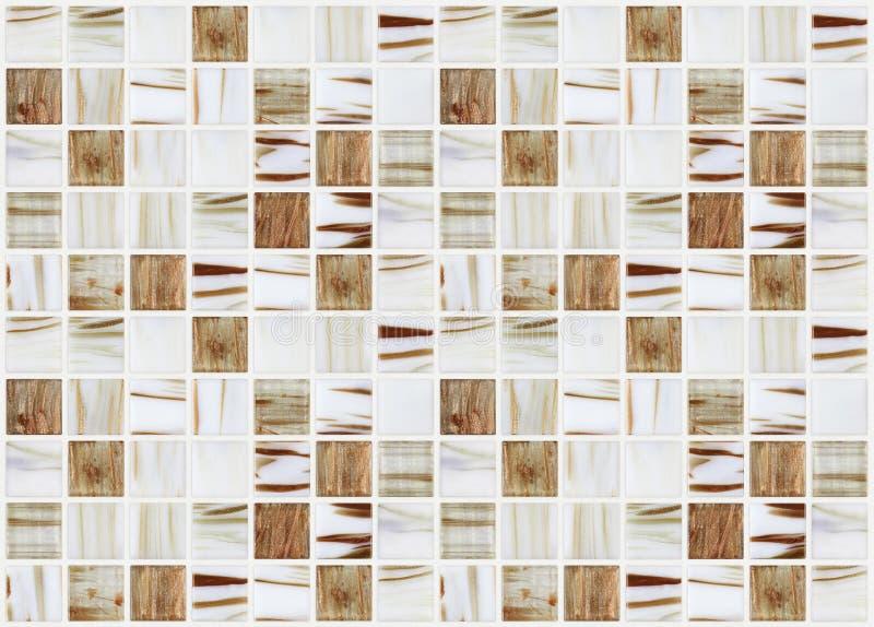 Petites tuiles carrées de marbre avec des effets beiges de couleur photographie stock