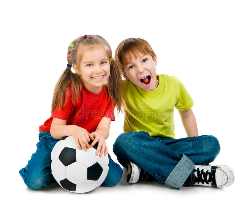 Petits enfants avec la boule de football photo stock