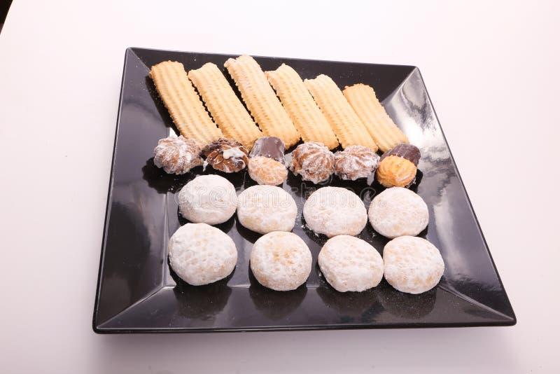 Petits fours, κέικ και μπισκότα στοκ εικόνα