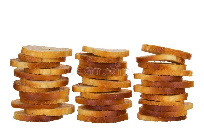 Petits mini ronds font des petits pains cuire au four sur un fond blanc photographie stock