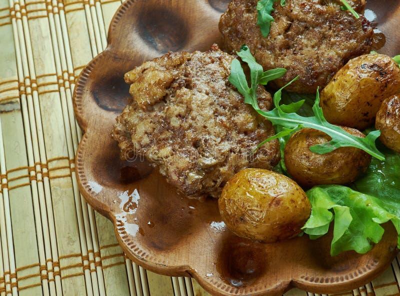 Petits pâtés allemands de viande photos stock