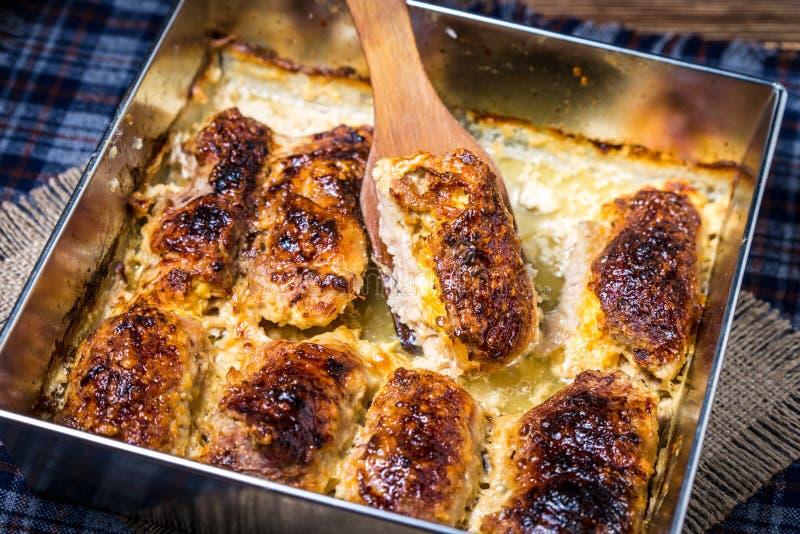 Petits pains de porc avec du fromage images libres de droits