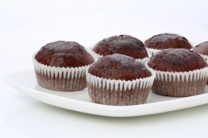 Petits pains, petits gâteaux de chocolat, d'isolement photos stock