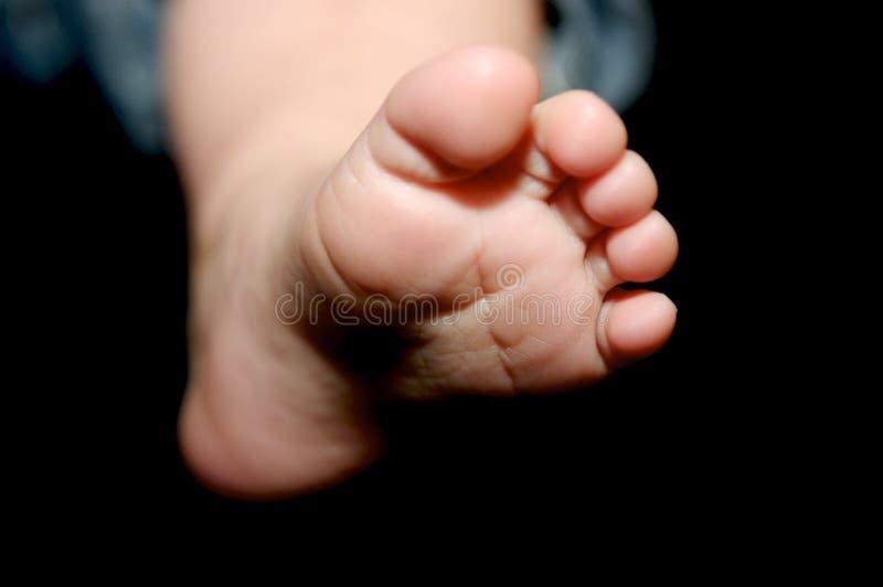 Petits pieds de chéri images stock