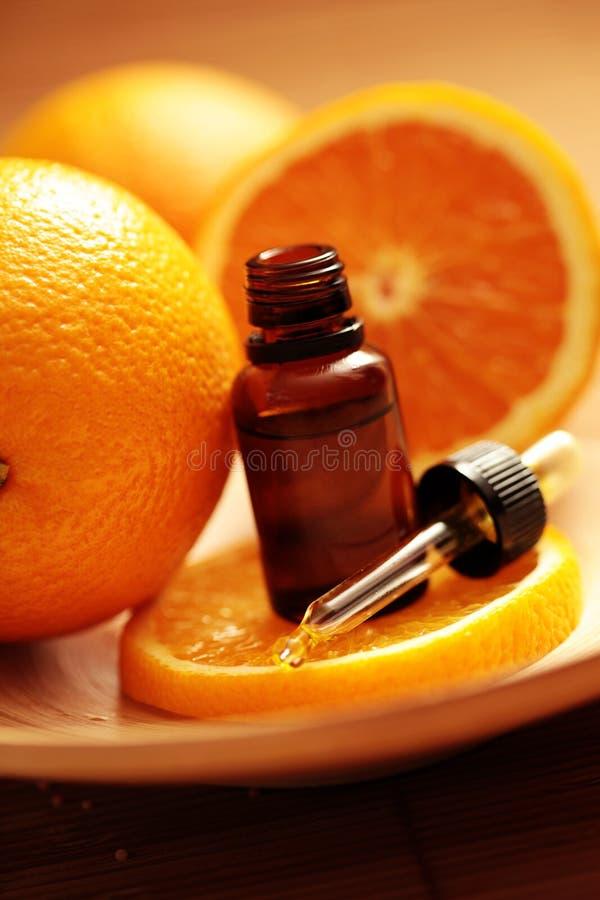 Petróleo esencial de la naranja fotos de archivo
