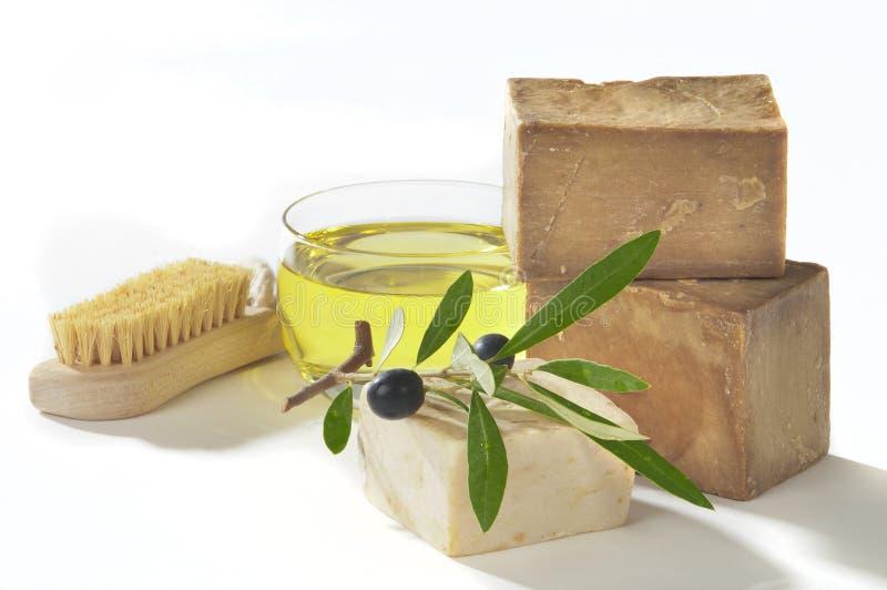 Petróleo verde-oliva de sabão de banho imagem de stock