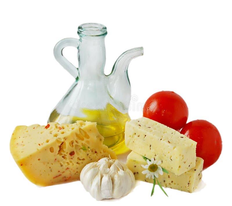 Petróleo verde-oliva e queijo fotos de stock