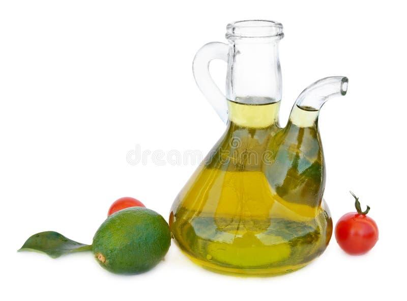 Petróleo verde-oliva e tomates fotografia de stock royalty free