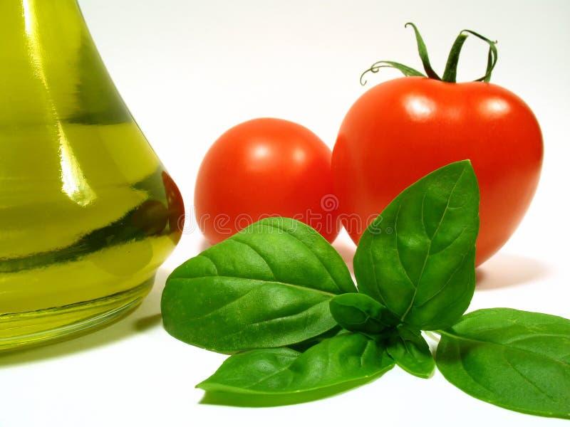 Petróleo verde-oliva e vegetais foto de stock royalty free