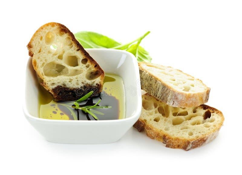 Petróleo verde-oliva e vinagre do pão imagem de stock royalty free