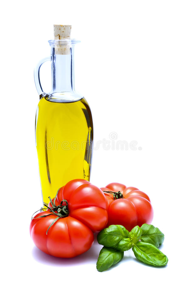 Petróleo verde-oliva, tomate e manjericão fotografia de stock