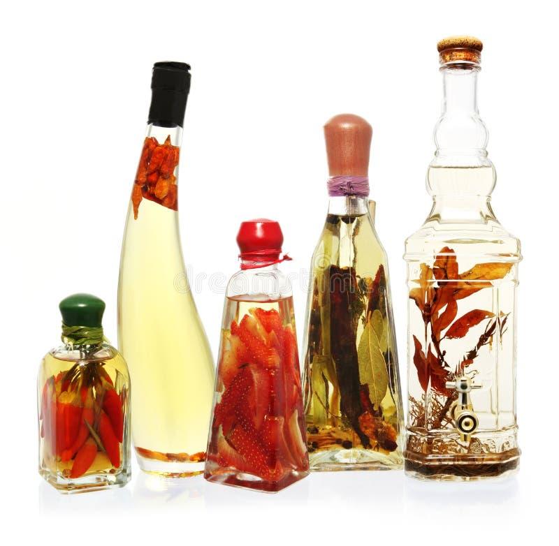 Petróleos e vinagres infundidos imagem de stock