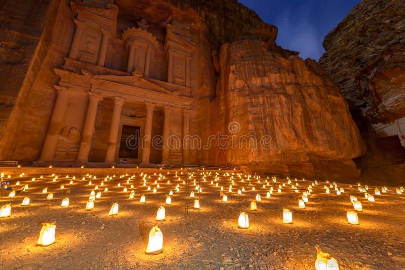 Petra by Night in Jordan. Treasury (Khasneh) in Petra, Jordan at night. Petra by Night in the light of 1,800 candles