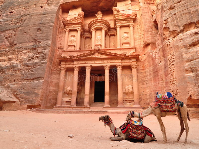 Petra Treasury and camels. The treasury at Petra with camels royalty free stock images