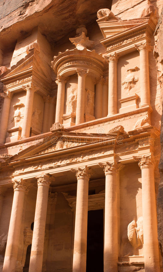 Petra Treasury from the Side. Close up of the Treasury, an ancient building in Petra, Jordan. The orange stone with columns carved by Nabataens is one of the stock photo